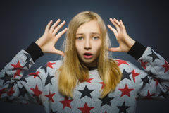 Closeup portrait young unsure hesitant nervous girl  on gray.  Royalty Free Stock Image