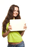 Closeup portrait of young woman. Closeup portrait of cute young woman holding a white page Royalty Free Stock Image
