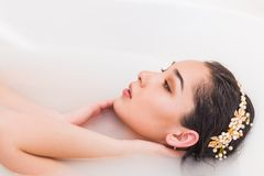 Closeup portrait of a young woman in the bathtube, Girl relaxing. In the water stock photo