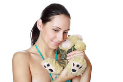 Closeup portrait of young woman with bear Stock Photos