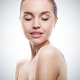 Closeup portrait of young woman with clean fresh skin Stock Photos