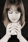 Closeup portrait of young woman with coffee (or tea)  Stock Image