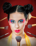 Funny girl with cosmetic brushes royalty free stock image