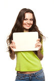 Closeup portrait of young woman. Closeup portrait of cute young woman holding a white page Royalty Free Stock Photography