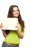 Closeup portrait of young woman. Closeup portrait of cute young woman holding a white page Stock Image