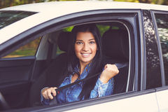 Closeup portrait of young woman fasten seat belt Stock Photos