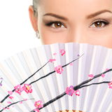 Closeup Portrait Of Young Woman With Folding Fan Stock Photo