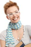 Closeup portrait of young woman in glasses. Closeup portrait of young gingerish short hair woman in white frame glasses smiling happy Royalty Free Stock Photography