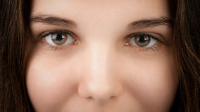 Closeup portrait of young woman with hazel eyes Royalty Free Stock Photography