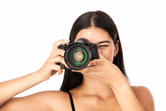 Closeup portrait of a young woman holding a camera. Over white Royalty Free Stock Photography