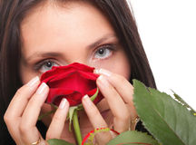 Closeup portrait of young woman holding a red rose Stock Photography