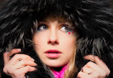 Closeup portrait of young woman in hood Royalty Free Stock Photo