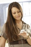 Closeup portrait of young woman with mobile. Closeup portrait of young woman using mobilephone, dialing Stock Images