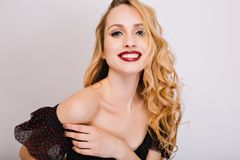 Closeup portrait of young woman, pretty blonde smiling, enjoying, having photoshoot. She has nice soft skin, makeup royalty free stock image