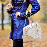 Closeup portrait of young woman standing in autumn park and hold Stock Image