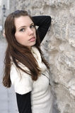Closeup portrait of young woman on stonewall Royalty Free Stock Photo