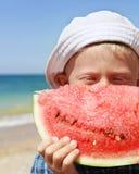 Closeup portreit boy with watermelon piece Royalty Free Stock Photos