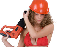 Closeup portriet of girl with hummer drill. Closeup portriet of beautiful curly girl in orange helmet with perforator drill royalty free stock photography