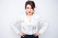 Closeup pose of an angry woman screaming in the white elegant jacket Royalty Free Stock Photo