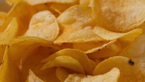 Closeup potato chips rotating loopable footage Stock Photo