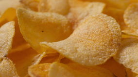 Closeup potato chips rotating loopable footage stock video footage
