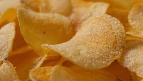Closeup potato chips rotating loopable footage Royalty Free Stock Photos