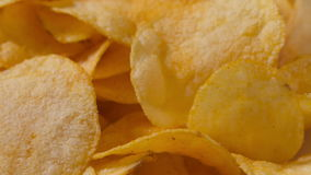 Closeup potato chips rotating loopable footage Stock Images
