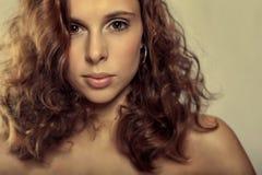 Closeup potrait young girl. Closeup potrait young brunette beutiful girl Stock Image