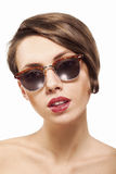 Closeup potrrait of girl in sunglasses. Closeup portrait of a beautiful girl with clean skin, sunglasses and red lipstick Stock Images