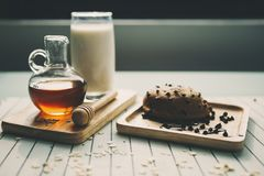 Closeup pouring honey to chocolate croissant. Healthy eating and traditional breakfast concept royalty free stock images