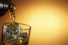 Pouring whiskey Royalty Free Stock Images