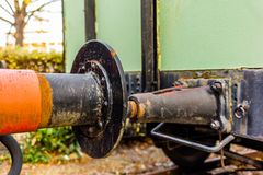 Closeup of the powerful bumpers of a train wagon royalty free stock photo
