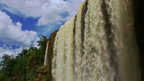 Closeup Powerful  Waterfall Flow by Rocks with Mist under Sky stock footage