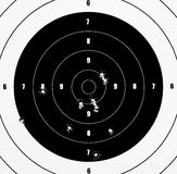A Closeup of a practice target. Used for shooting with bullet holes in it Royalty Free Stock Photos