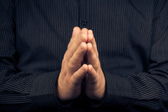 Closeup praying white man dark shirt Royalty Free Stock Photography