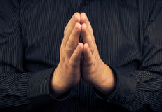 Closeup praying white man dark shirt Stock Images