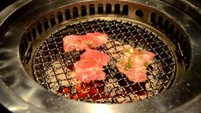 Closeup of premium slice sirloin on hot charcoal grill pan. stock footage