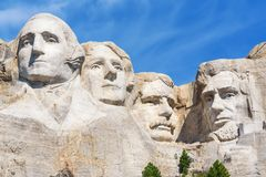 Closeup of presidential sculpture at Mount Rushmore national memorial, USA. Blue sky background. Royalty Free Stock Images