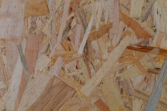 Chipboard. Closeup of the pressed beige brown chipboard Stock Image