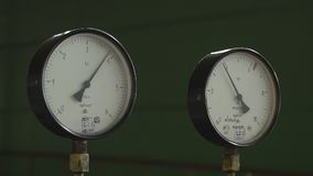 Closeup of pressure gauge,pressure gauge measuring gas pressure. Pipes and valves at oil and gas industrial plant. HD stock video footage