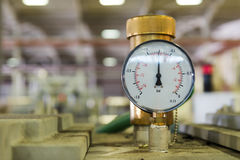Closeup of a pressure meter on a machine Stock Photography