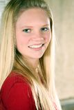 Closeup of pretty blond teen girl. Portrait of pretty young teen girl with long blonde hair Royalty Free Stock Images