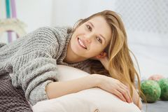 Closeup of pretty and cute smiling woman in studio stock image