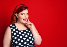 Pin up girl vintage. Beautiful woman pinup style portrait in retro dress and polka dot dress. Studio shot. stock photo