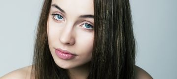 Closeup pretty female face - purity and sensuality Royalty Free Stock Image