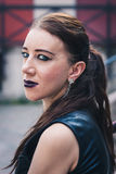 Closeup of a pretty goth girl posing in urban landscape Royalty Free Stock Photo
