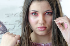 Closeup of pretty lady with makeup. Closeup of gorgeous lady with pink tone make-up, fleshy lips , almond eyes long brunette hair, model looking at the camera stock images