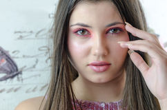 Closeup of pretty lady with makeup. Closeup of gorgeous lady with pink tone make-up, fleshy lips , almond eyes long brunette hair, model looking at the camera stock photography