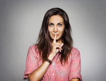 Closeup of pretty woman making silent gesture Royalty Free Stock Photography