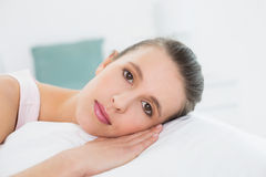 Closeup of a pretty woman relaxing in bed Stock Photos